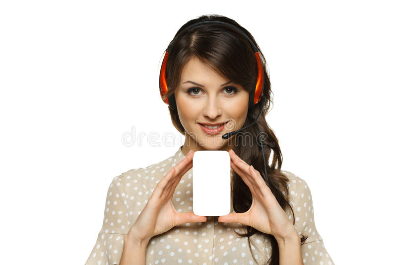 Mulher nos auriculares que guardaram o cartão vazio fotografia de stock royalty free