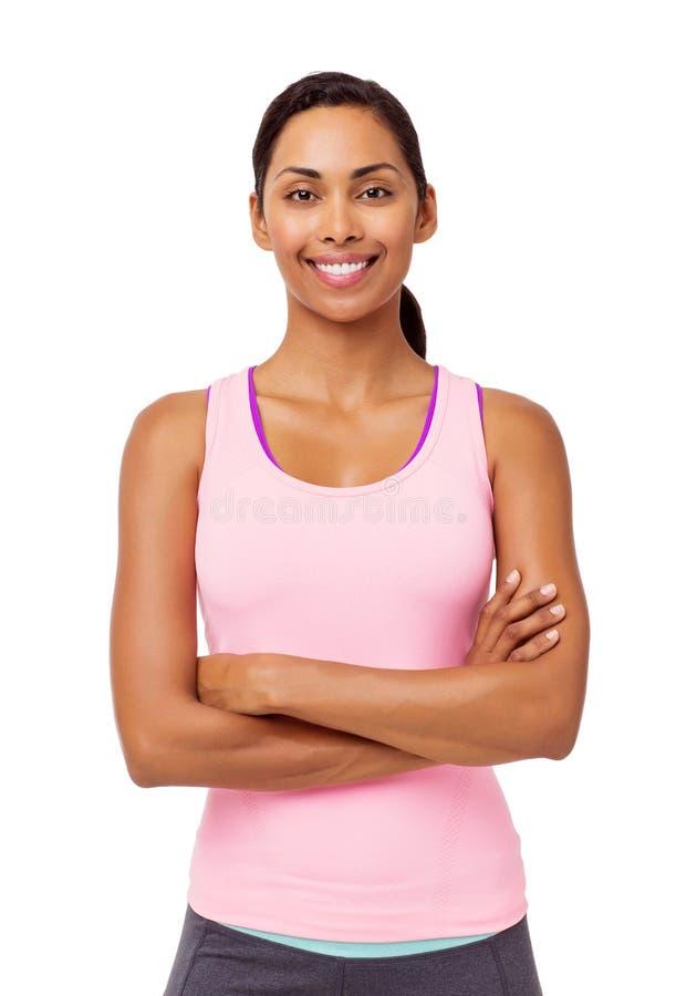 Mulher nos braços eretos da roupa dos esportes cruzados fotografia de stock royalty free