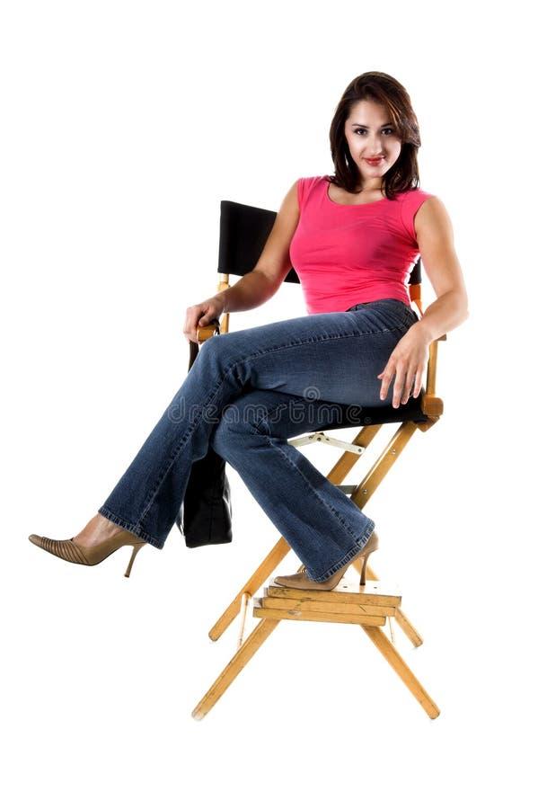 Mulher nos diretores Cadeira imagens de stock