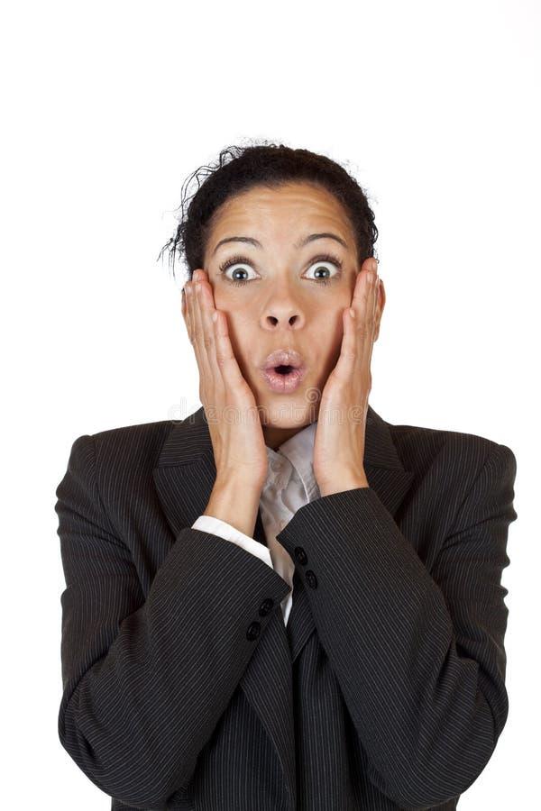Mulher nos olhares do terno de negócio surpreendidos muito fotos de stock