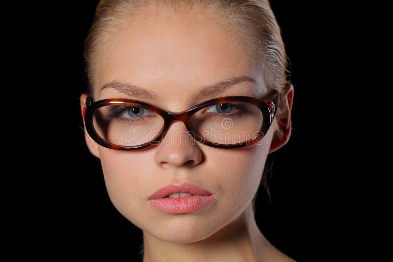 Mulher nos vidros imagens de stock