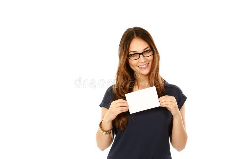 Mulher nos vidros que guardaram o cartão de nota imagens de stock