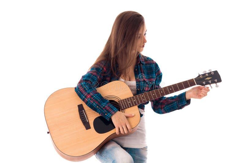 Mulher nova atrativa com guitarra fotografia de stock