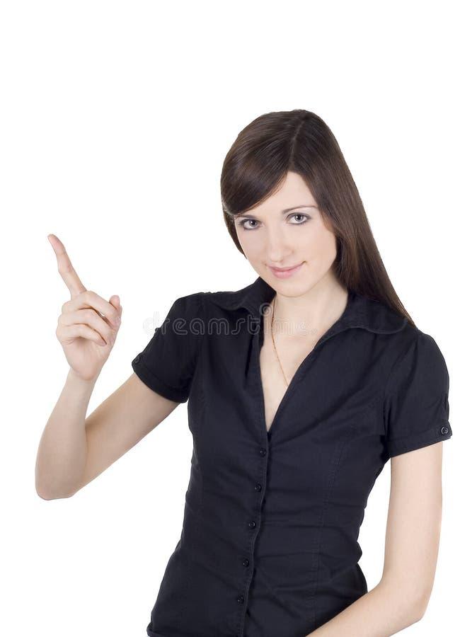 Mulher nova atrativa que aponta seu dedo imagem de stock