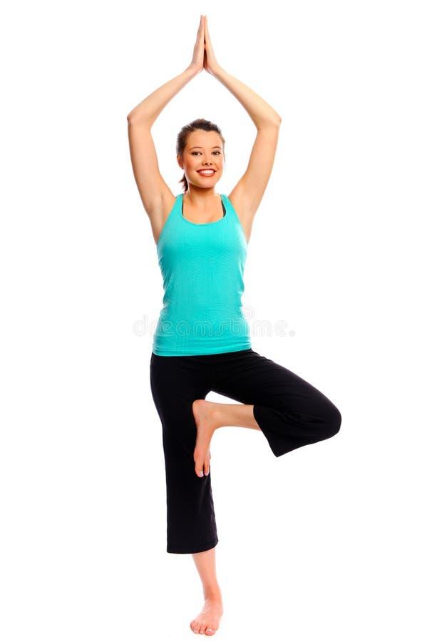 Mulher nova atrativa que faz a ioga fotos de stock
