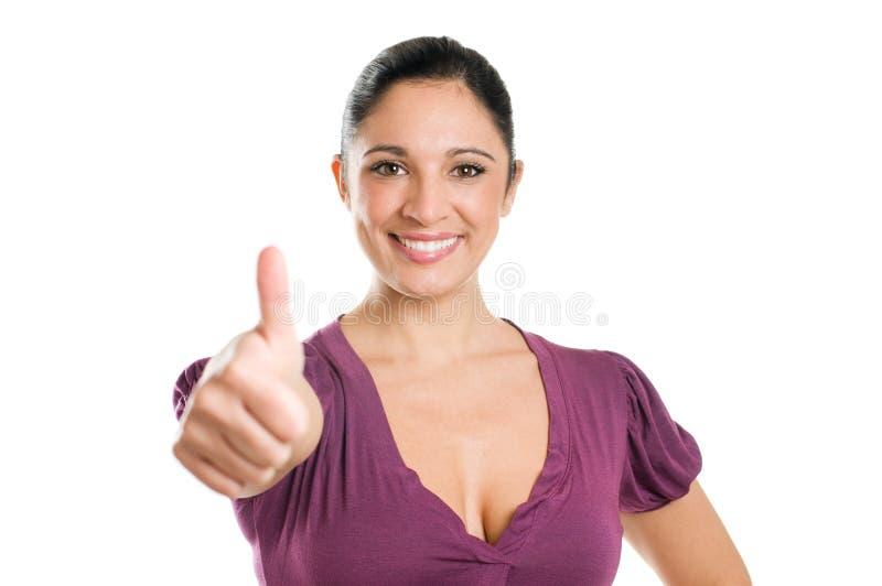 Mulher nova bem sucedida que mostra o polegar acima fotos de stock