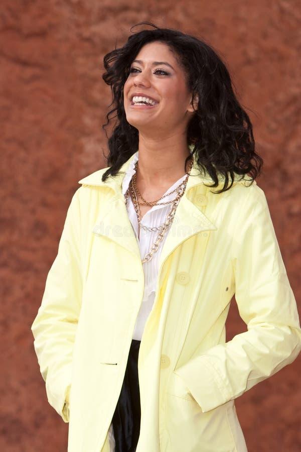 Mulher nova Biracial no raincoat fotos de stock royalty free