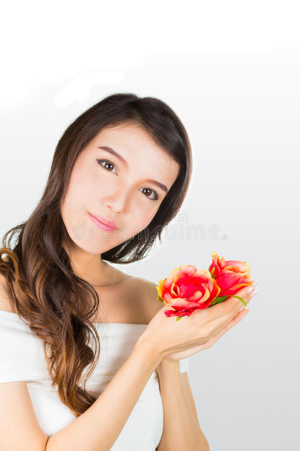 Mulher nova bonita com flores foto de stock royalty free