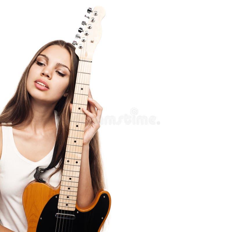 Mulher nova bonita com guitarra fotografia de stock