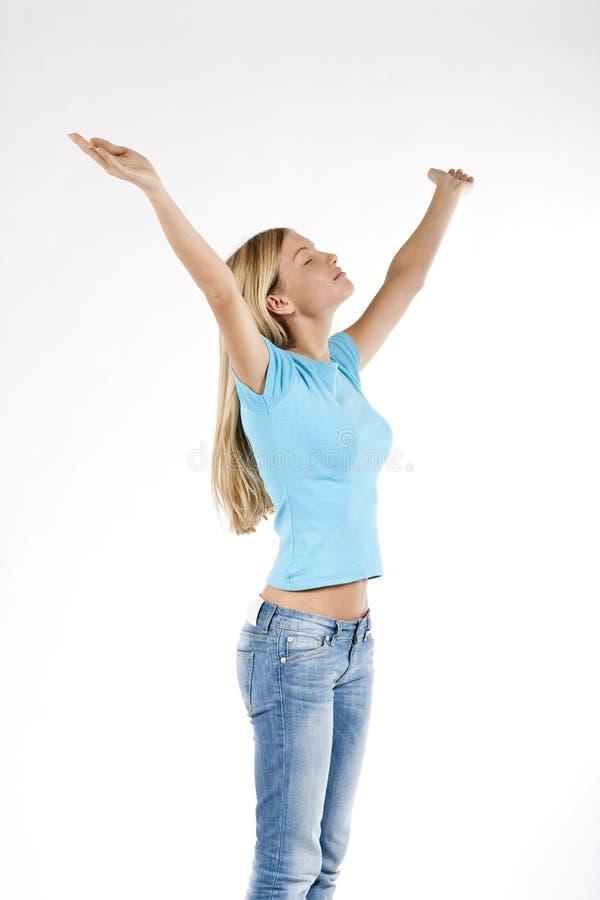 Mulher nova bonita com os braços levantados imagens de stock royalty free