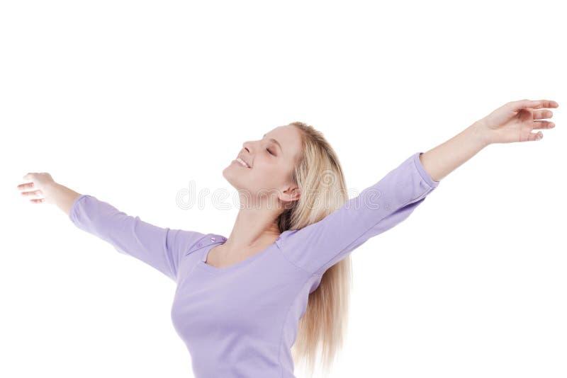 Mulher nova bonita com os braços levantados imagem de stock