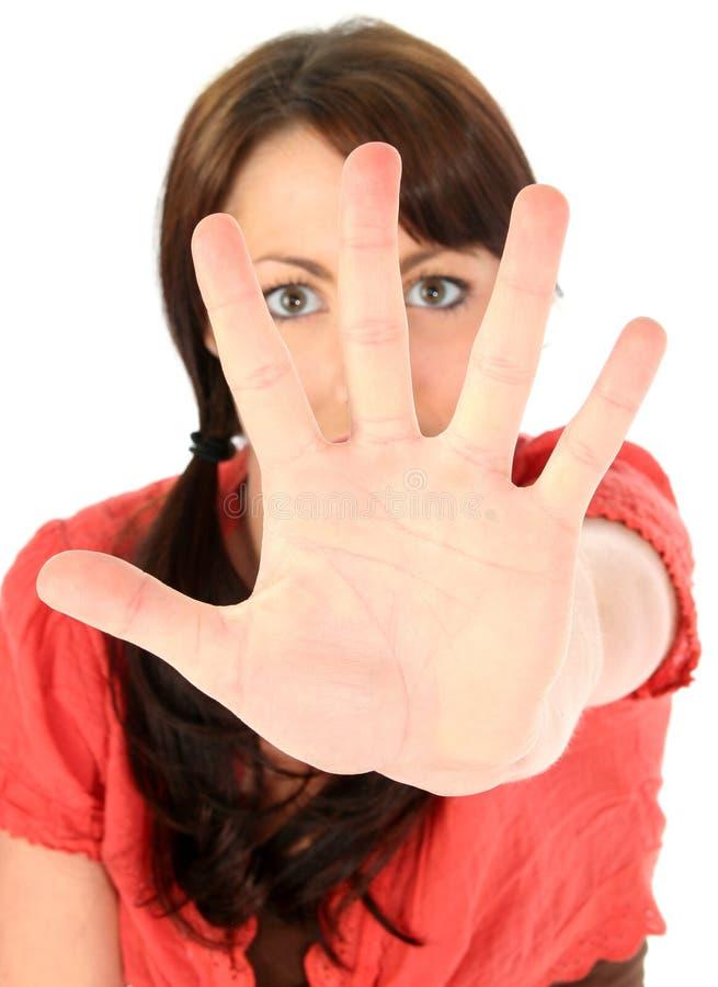 Mulher nova bonita com a palma para a câmera imagem de stock royalty free