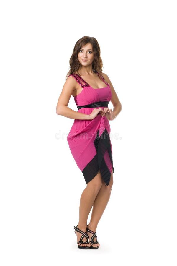 Mulher nova bonita na cor-de-rosa imagens de stock