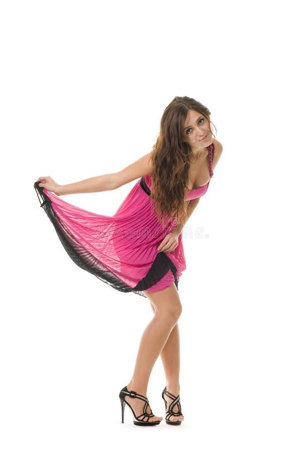 Mulher nova bonita na cor-de-rosa foto de stock