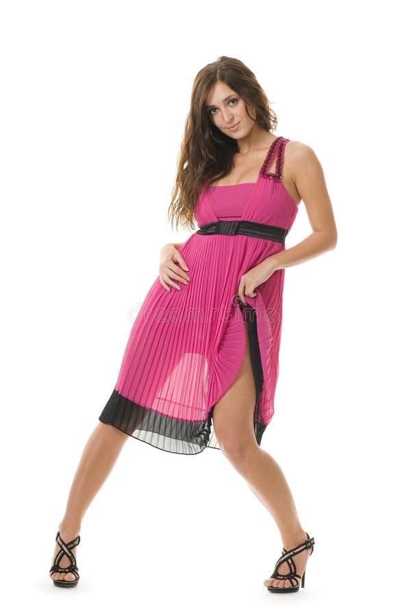 Mulher nova bonita na cor-de-rosa fotografia de stock royalty free