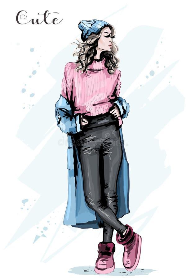Mulher nova bonita na roupa do inverno Menina bonito à moda no chapéu da malha Levantamento do modelo de forma ilustração royalty free
