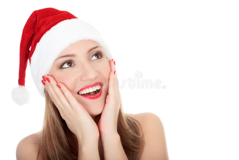 Mulher nova bonita no chapéu desgastando vermelho de Santa. foto de stock
