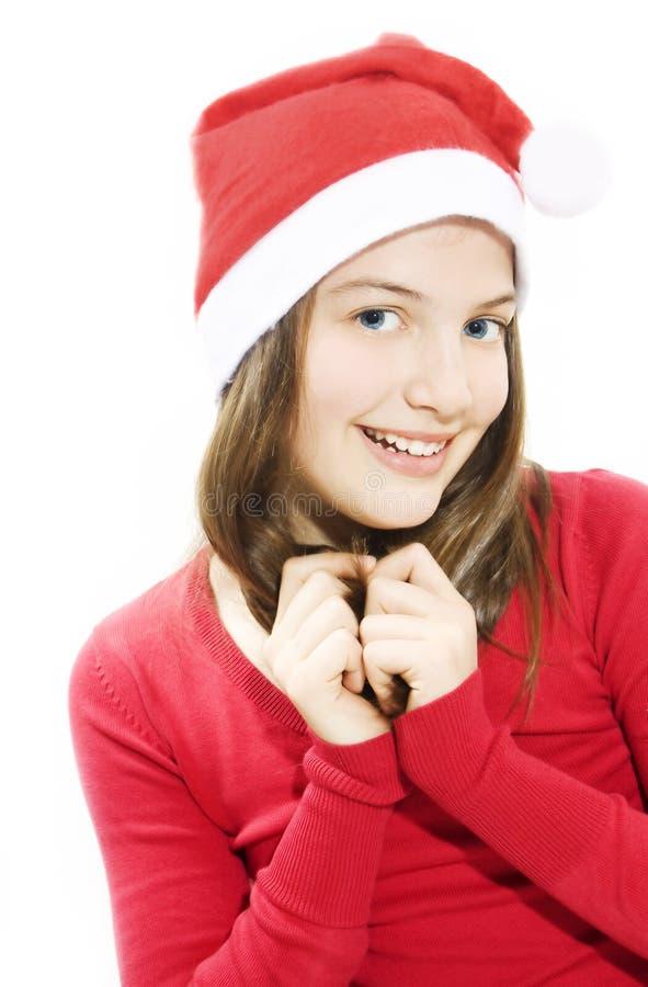 Mulher nova bonita no chapéu desgastando vermelho de Santa. imagem de stock royalty free