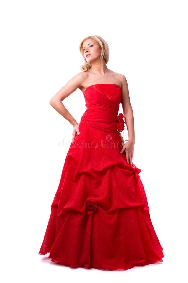 Mulher nova bonita no vestido longo vermelho fotos de stock royalty free