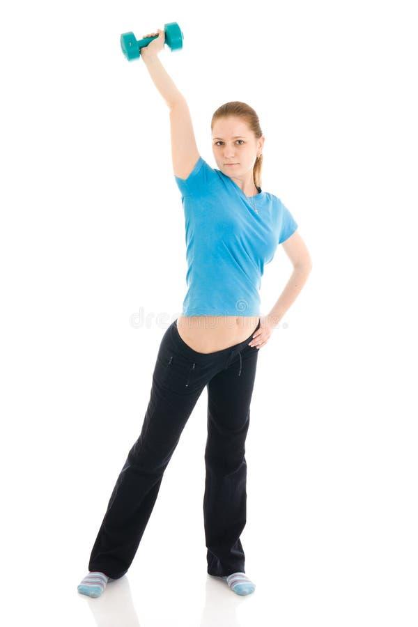 A mulher nova bonita que faz o exercício isolado fotografia de stock