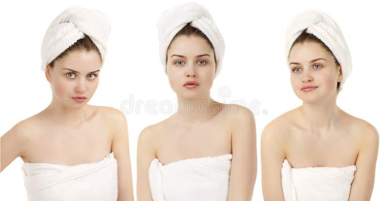 Mulher nova bonita que levanta na toalha branca imagem de stock
