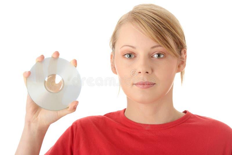 Mulher nova bonita que sustenta um disco fotos de stock