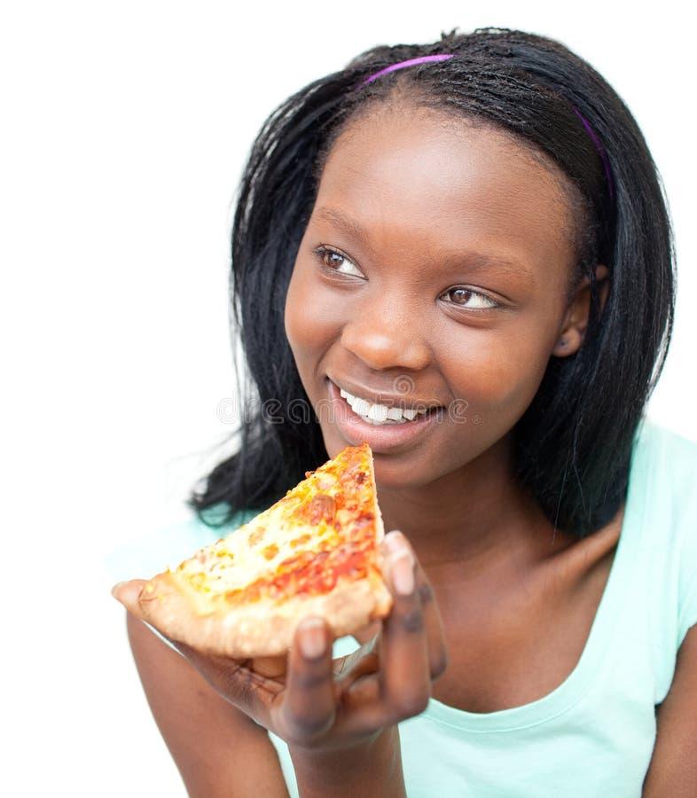 Mulher nova Charming que come uma pizza imagem de stock royalty free
