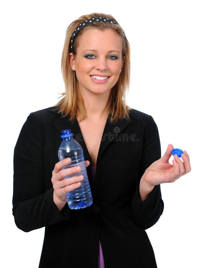 Mulher nova com água engarrafada fotos de stock