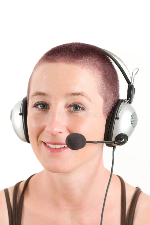 Mulher nova com auriculares imagens de stock