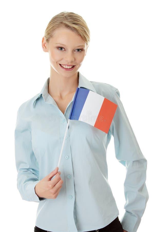 Mulher nova com bandeira de France imagem de stock royalty free