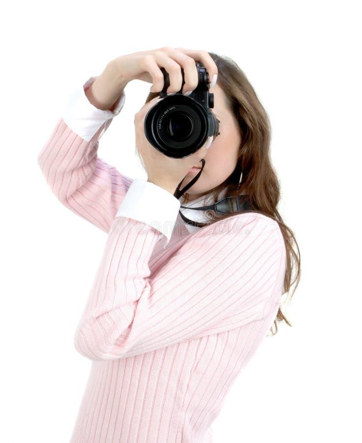 Mulher nova com câmera fotografia de stock