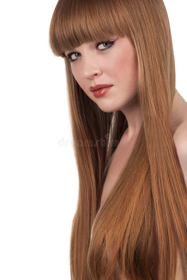 Mulher nova com cabelo vermelho longo imagens de stock