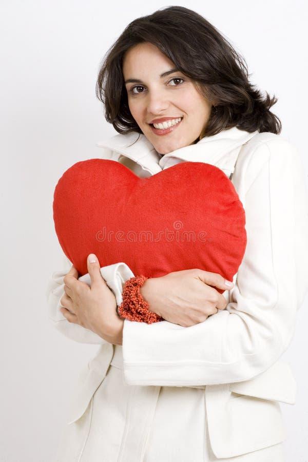 Mulher nova com coração fotografia de stock royalty free