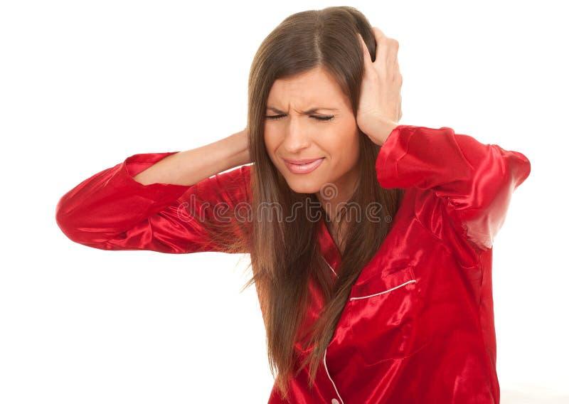 Mulher nova com dor, dor de cabeça imagem de stock