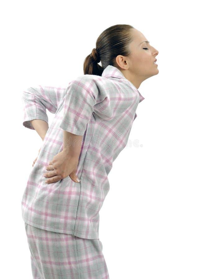 Mulher nova com dor lombar imagens de stock