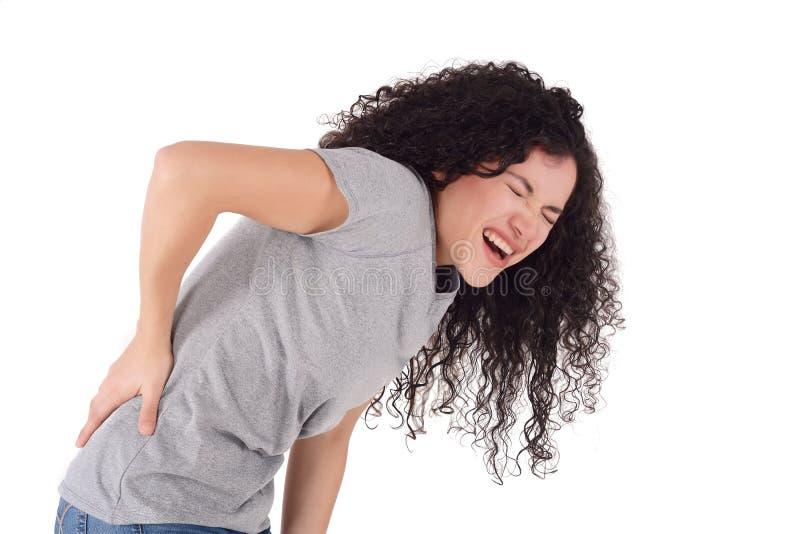 Mulher nova com dor traseira fotos de stock royalty free