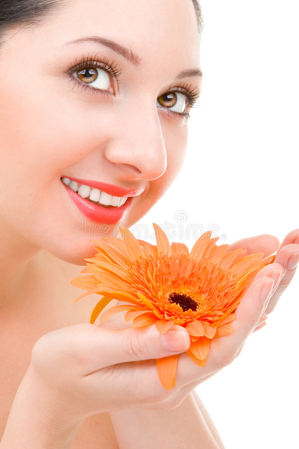 Mulher nova com flor fotografia de stock royalty free