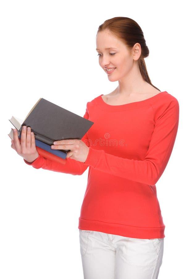 Mulher nova com livros foto de stock