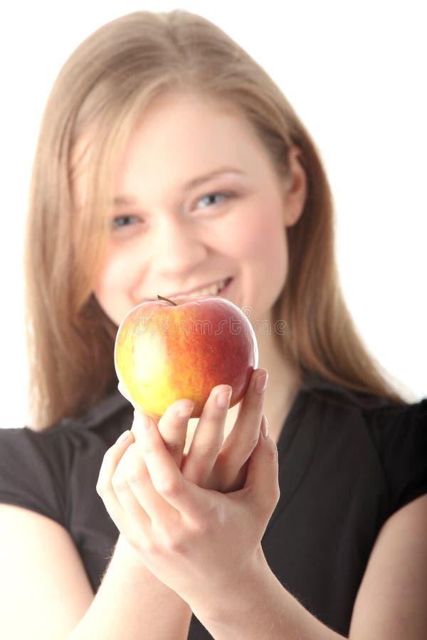 Download Mulher nova com maçã foto de stock. Imagem de coma, ocasional - 12801444