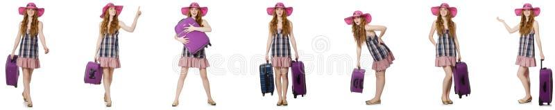 Mulher nova com a mala de viagem isolada no branco imagem de stock royalty free