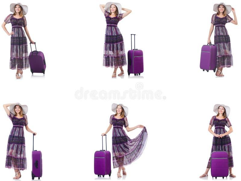 Mulher nova com a mala de viagem isolada no branco fotografia de stock