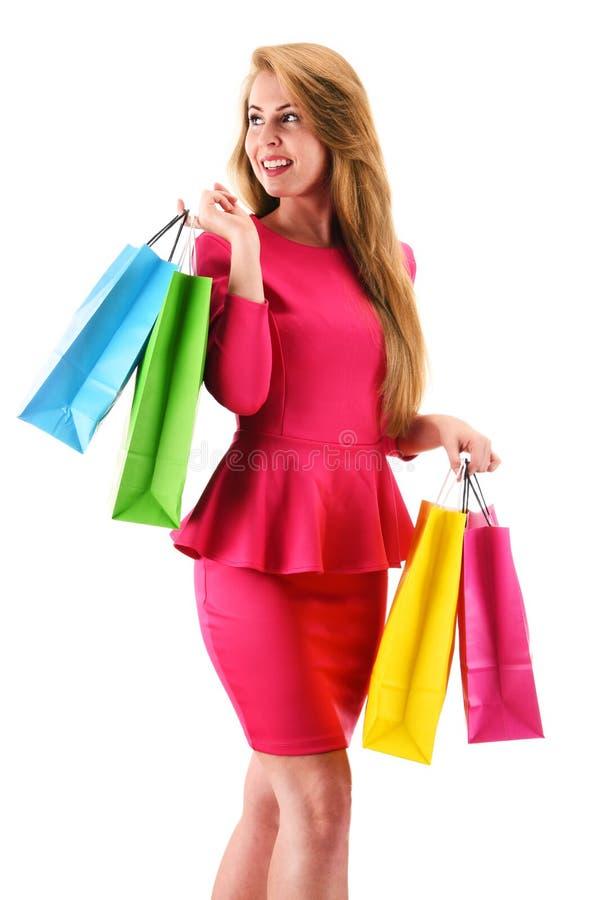 Mulher nova com os sacos de compra isolados no branco imagem de stock royalty free