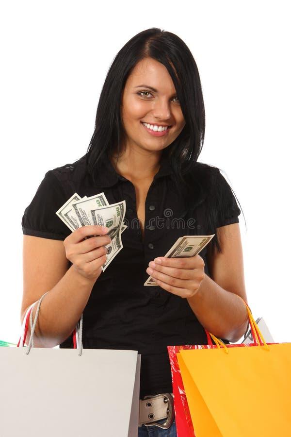 Mulher nova com os sacos do dinheiro e de compra fotos de stock