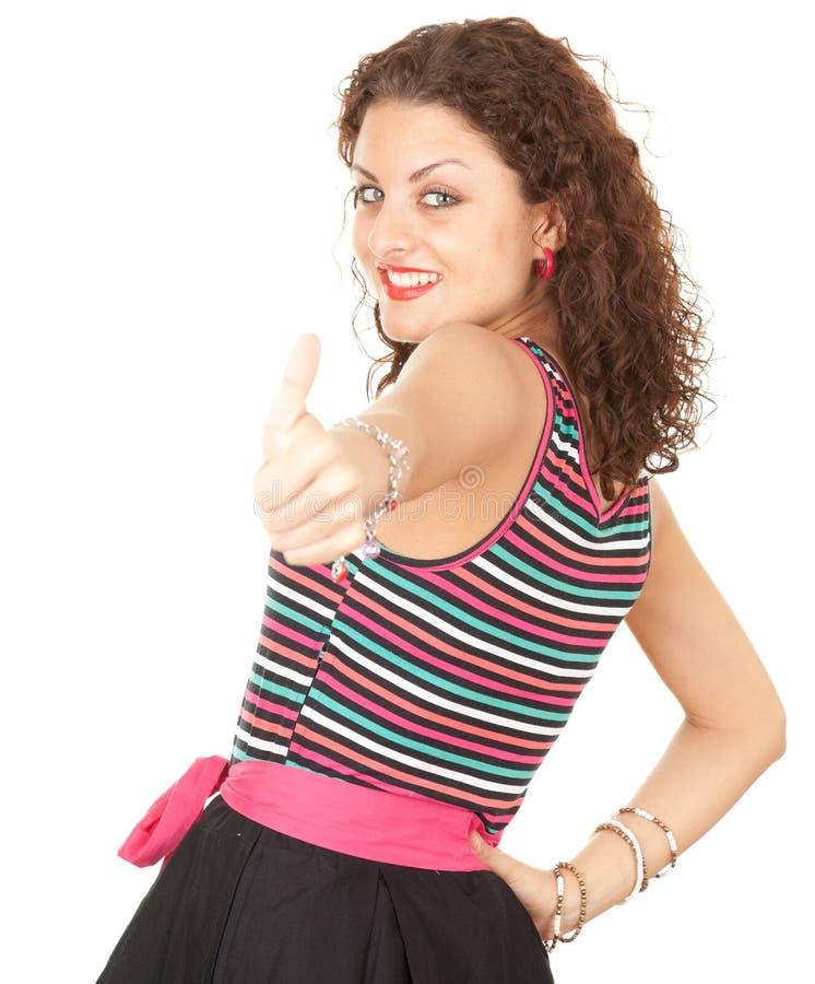 Mulher nova com polegar acima foto de stock