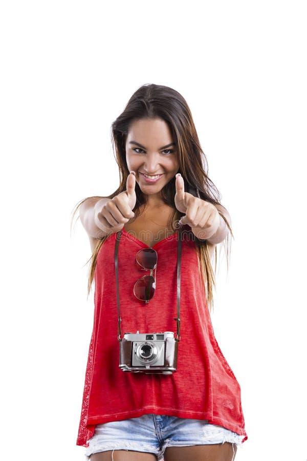 Mulher nova com polegares acima fotografia de stock