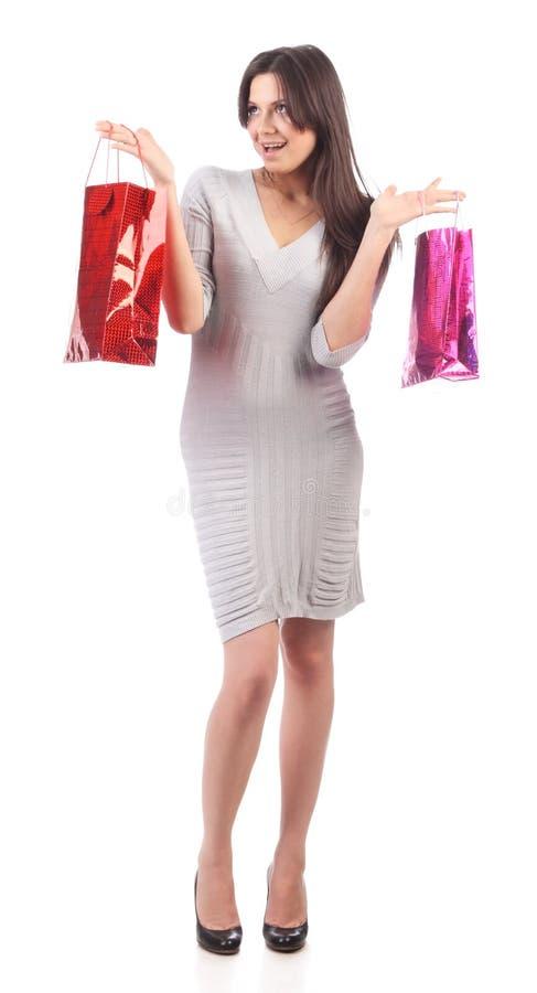 Mulher nova com saco de compra. Disconto. Isolado fotos de stock