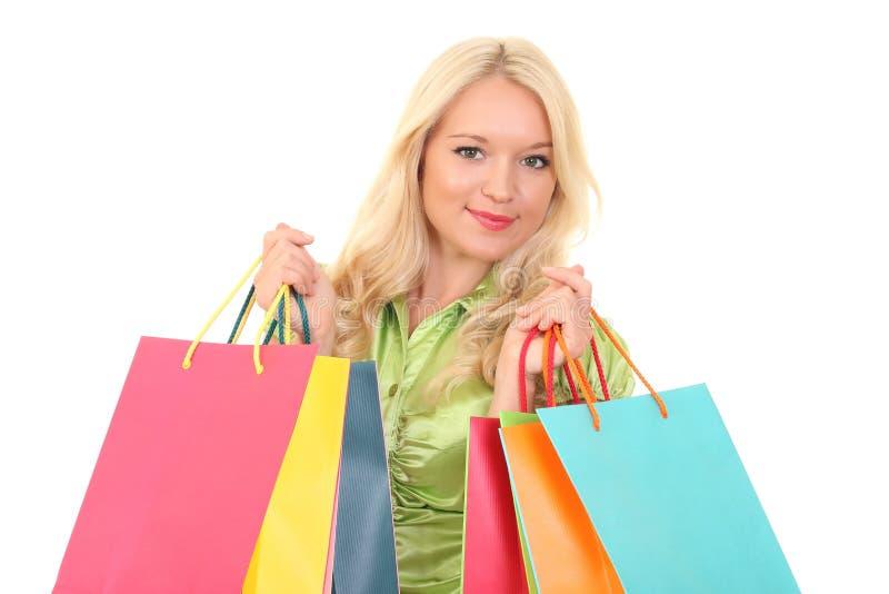 Mulher nova com sacos foto de stock