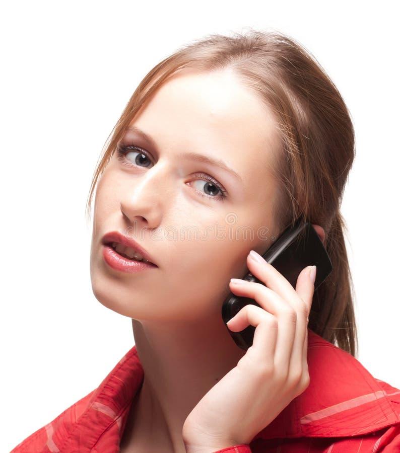 Mulher nova com telefone fotografia de stock