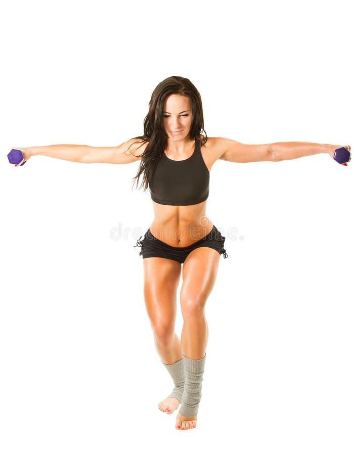 Mulher nova da ioga que faz o exercício na pose da ioga no fundo branco isolado. Esportes do conceito, aptidão fotografia de stock royalty free