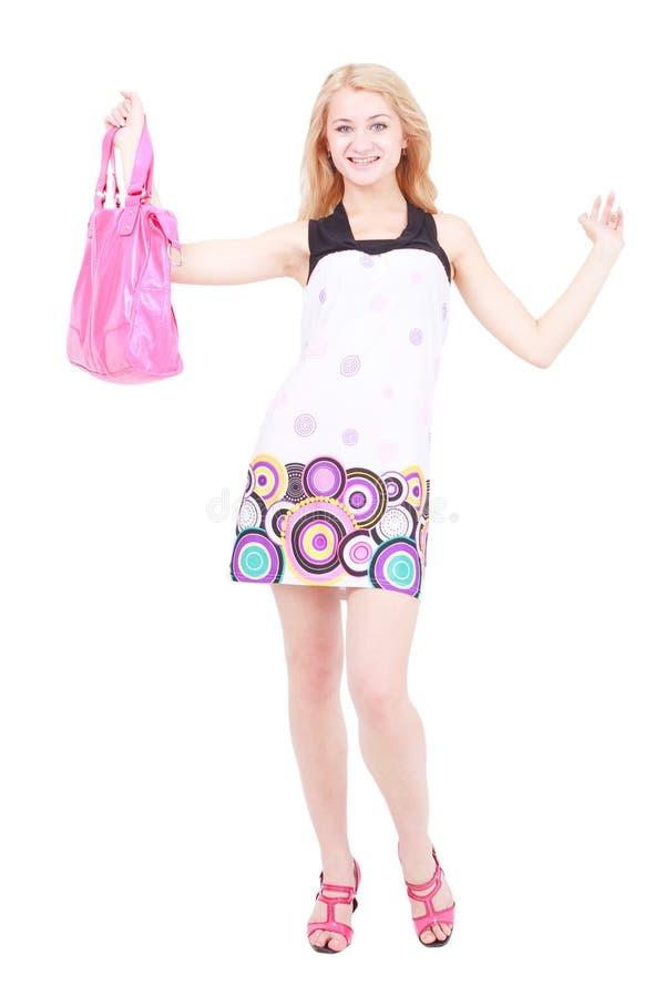 Mulher nova de sorriso com bolsa fotos de stock royalty free